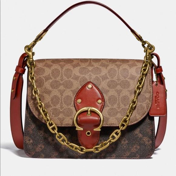 Coach signature print purse